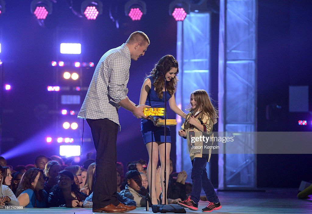 J.J. Watt, Laura Marano and Sam Gordon onstage at the Third Annual Hall of Game Awards hosted by Cartoon Network at Barker Hangar on February 9, 2013 in Santa Monica, California. 23270_003_JK_0701.JPG