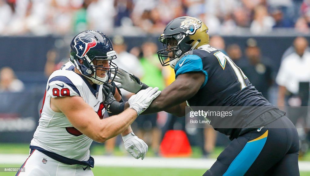 J.J. Watt #99 of the Houston Texans and Cam Robinson #74 of the Jacksonville Jaguars battle one on one at NRG Stadium on September 10, 2017 in Houston, Texas.