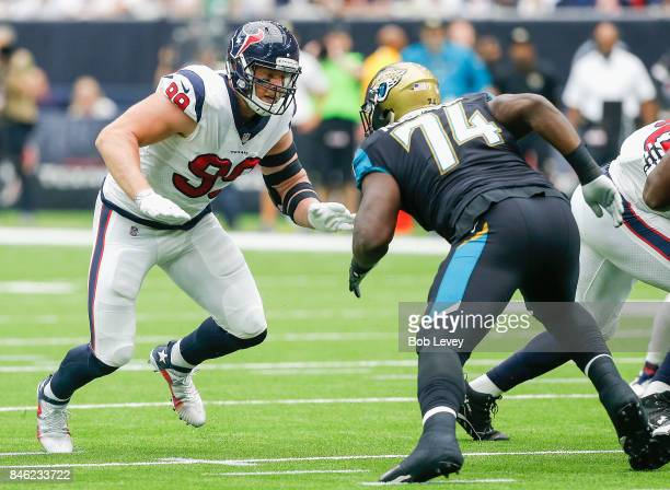 J Watt of the Houston Texans and Cam Robinson of the Jacksonville Jaguars battle one on one at NRG Stadium on September 10 2017 in Houston Texas