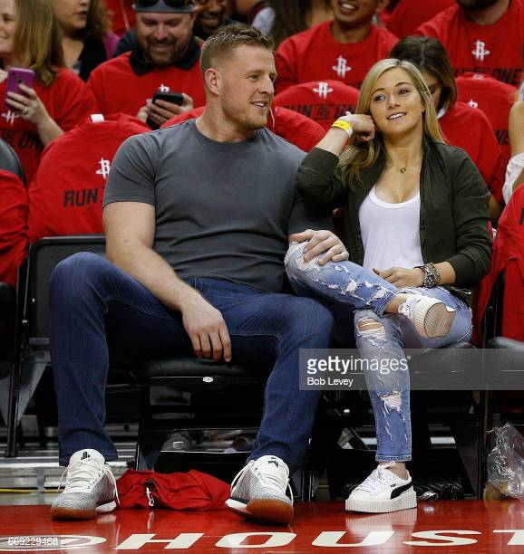 JJ Watt of the Houston Texans and girlfriend Kealia Ohai courtside during Game One of the first round of the Western Conference 2017 NBA Playoffs at...