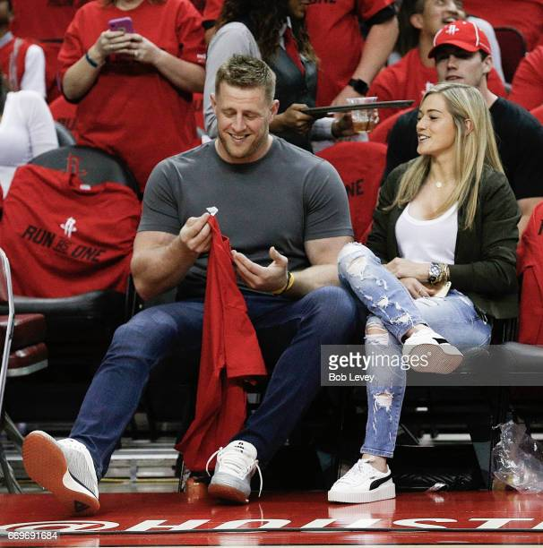J Watt of the Houston Texans and girlfriend Kealia Ohai of the Houston Dash court side during Game One of the first round of the Western Conference...