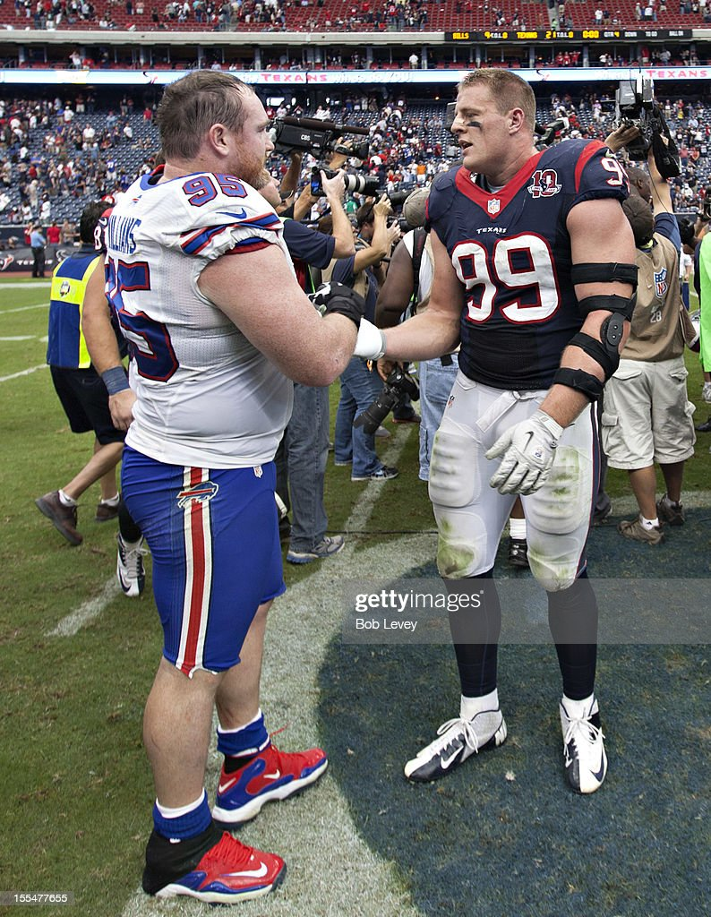<a gi-track='captionPersonalityLinkClicked' href=/galleries/search?phrase=J.J.+Watt&family=editorial&specificpeople=6243554 ng-click='$event.stopPropagation()'>J.J. Watt</a> #99 of the Houston Texans and <a gi-track='captionPersonalityLinkClicked' href=/galleries/search?phrase=Kyle+Williams+-+American+Football+Defensive+Tackle&family=editorial&specificpeople=9642838 ng-click='$event.stopPropagation()'>Kyle Williams</a> #95 of the Buffalo Bills chat at the end of the game at Reliant Stadium on November 4, 2012 in Houston, Texas. Houston defeated Buffalo 21-9.