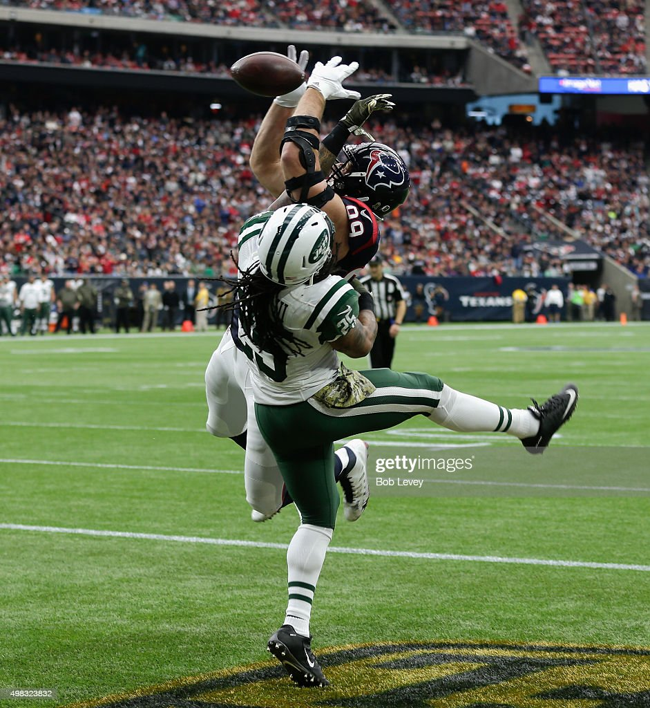 J.J. Watt #99 of the Houston Texans can't come up with the pass as he his defended by Calvin Pryor #25 of the New York Jets in the first quarter at NRG Stadium on November 22, 2015 in Houston, Texas.