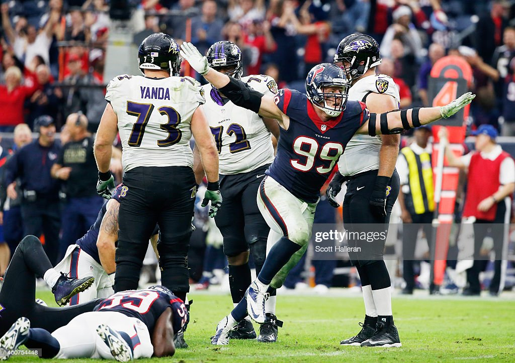 J.J. Watt #99 of the Houston Texans celebrates after a sack during their game against the Baltimore Ravens at NRG Stadium on December 21, 2014 in Houston, Texas.
