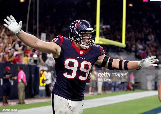 J Watt of the Houston Texans celebrates an Indianapolis Colts fumble after he returned it for a touchdown in the fourth quarter in a NFL game on...