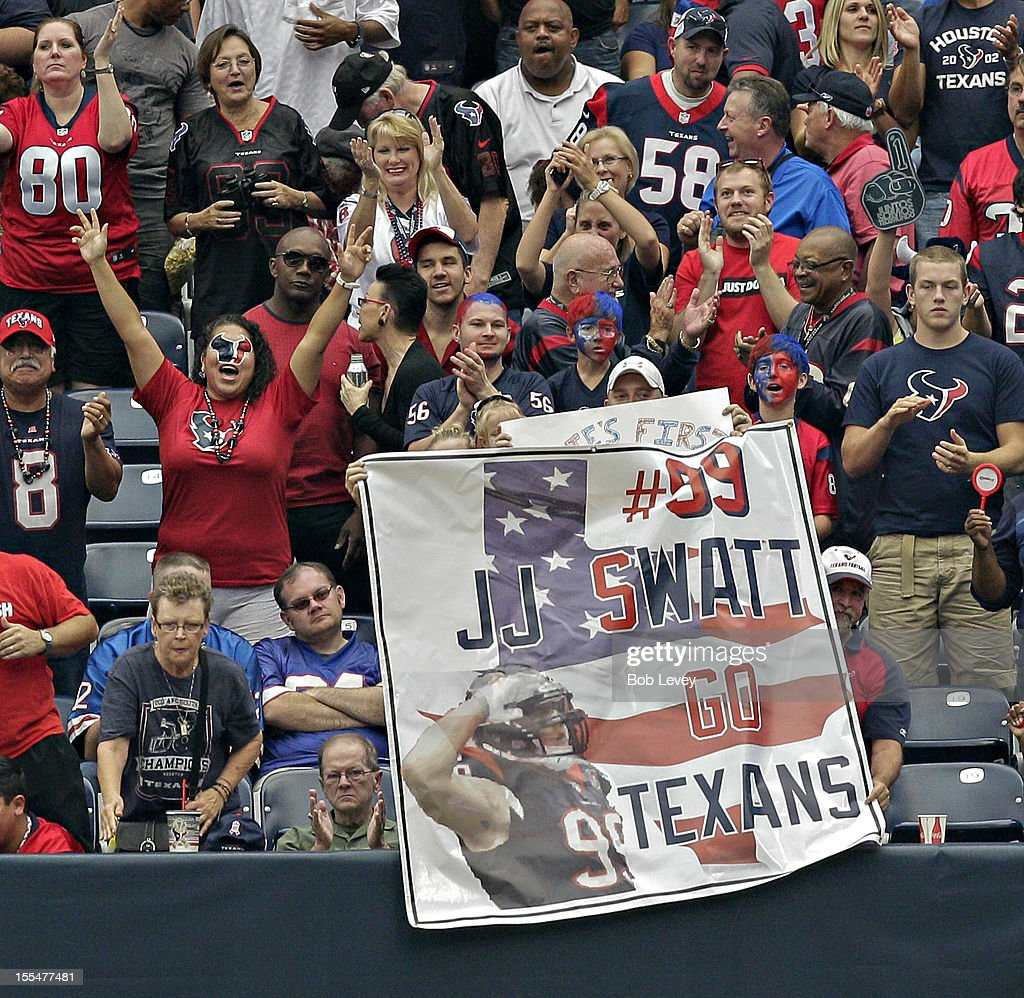 <a gi-track='captionPersonalityLinkClicked' href=/galleries/search?phrase=J.J.+Watt&family=editorial&specificpeople=6243554 ng-click='$event.stopPropagation()'>J.J. Watt</a> #99 of the Houston Texans fans show their support during a game against the Buffalo Bills at Reliant Stadium on November 4, 2012 in Houston, Texas. Houston defeated Buffalo 21-9.
