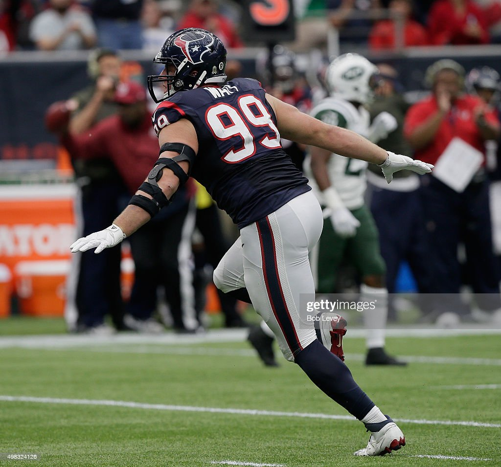 J.J. Watt #99 of the Houston Texans gets the crowd into the against the New York Jets at NRG Stadium on November 22, 2015 in Houston, Texas.