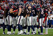 J Watt of the Houston Texans huddles up with his defense during the first half during their game against the Buffalo Bills at NRG Stadium on...