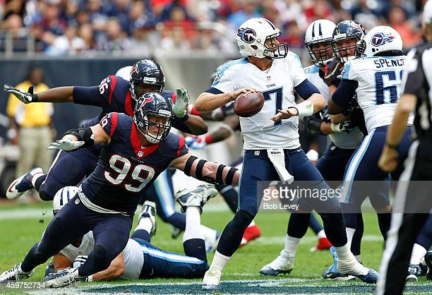 J Watt of the Houston Texans pressures Zach Mettenberger of the Tennessee Titans in the second quarter in a NFL game on November 30 2014 at NRG...