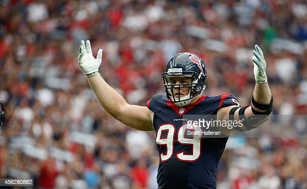 J Watt of the Houston Texans pumps up the crowd in the fourth quarter of their game against the Buffalo Bills at NRG Stadium on September 28 2014 in...