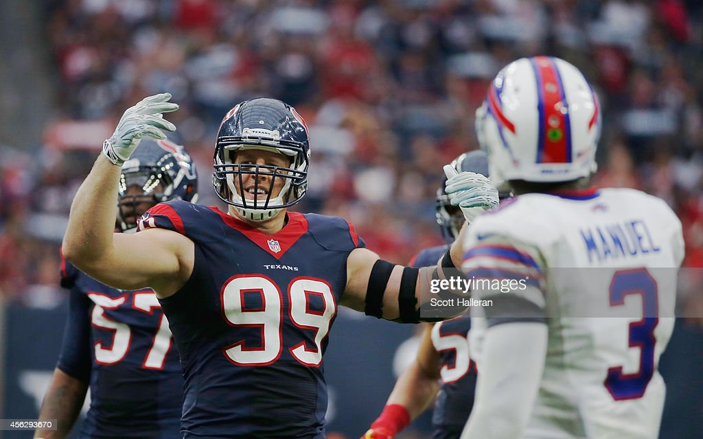 <a gi-track='captionPersonalityLinkClicked' href=/galleries/search?phrase=J.J.+Watt&family=editorial&specificpeople=6243554 ng-click='$event.stopPropagation()'>J.J. Watt</a> #99 of the Houston Texans pumps up the crowd in the fourth quarter as EJ Manuel #3 of the Buffalo Bills looks on at NRG Stadium on September 28, 2014 in Houston, Texas.