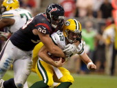 J Watt of the Houston Texans sacks Aaron Rodgers of the Green Bay Packers in the third quarter at Reliant Stadium on October 14 2012 in Houston Texas