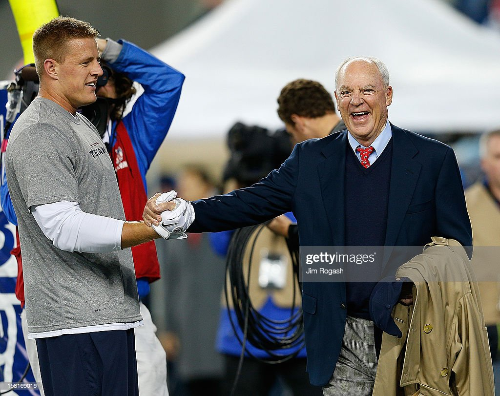 J.J. Watt #99 of the Houston Texans shakes hands with team owner Bob McNair before a game with the New England Patriots at Gillette Stadium on December 10, 2012 in Foxboro, Massachusetts.