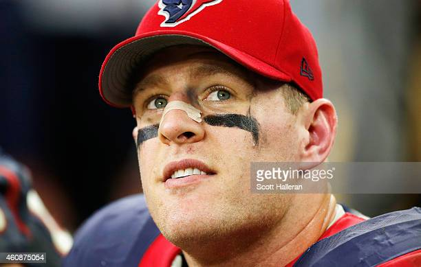 J Watt of the Houston Texans sits on the bench late in their game against the Jacksonville Jaguars at NRG Stadium on December 28 2014 in Houston Texas