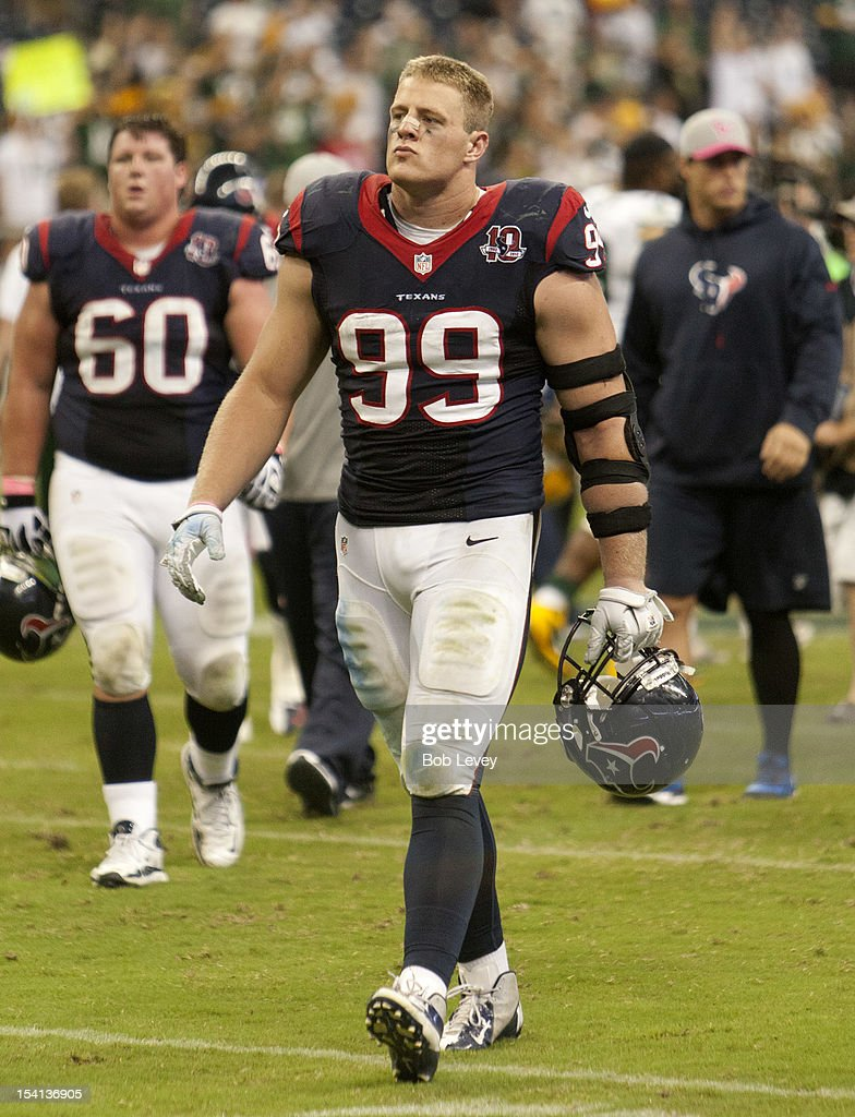 J.J. Watt #99 of the Houston Texans walks off the field after losing to the Green Bay Packers at Reliant Stadium on October 14, 2012 in Houston, Texas. Green Bay Packers defeated Houston 42-24.