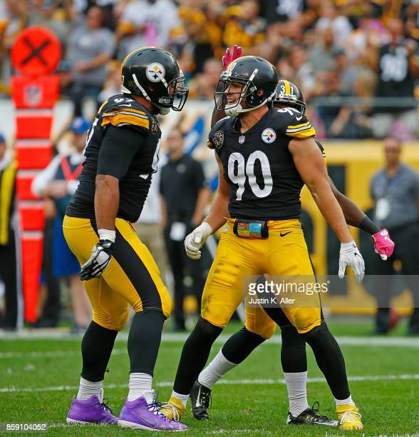 J Watt of the Pittsburgh Steelers celebrates with Cameron Heyward after a defensive stop in the second half during the game against the Jacksonville...