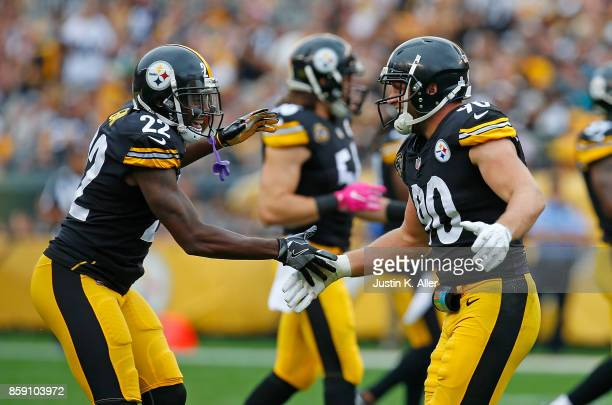 J Watt of the Pittsburgh Steelers celebrates with William Gay after a defensive stop in the second half during the game against the Jacksonville...