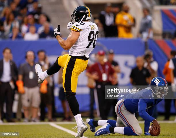 J Watt of the Pittsburgh Steelers reacts after sacking quarterback Josh Johnson of the New York Giants during the first quarter of an NFL preseason...