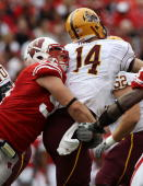 J Watt of the Wisconsin Badgers hits Steven Threet of the Arizona State Sun Devils at Camp Randall Stadium on September 18 2010 in Madison Wisconsin...