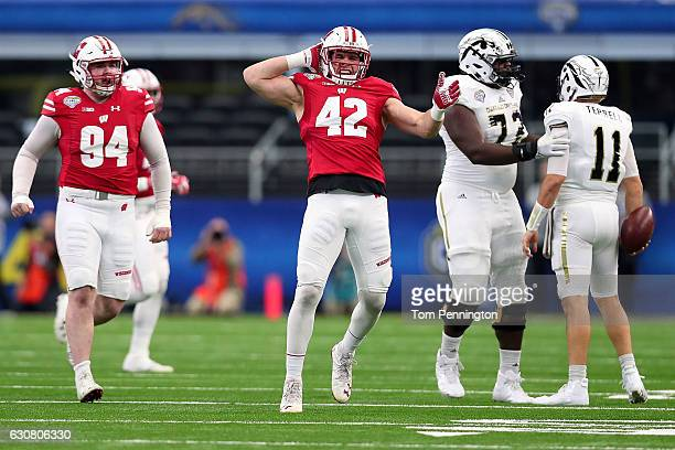 J Watt of the Wisconsin Badgers makes a sack during the 81st Goodyear Cotton Bowl Classic between Western Michigan and Wisconsin at ATT Stadium on...