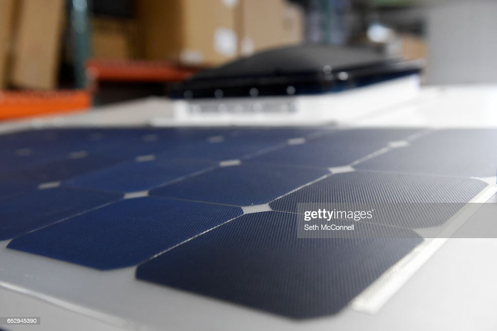 100 watt solar panel on the roof of a camper at Into the Wild Overland on March 9, 2017 in Arvada, Colorado. Into the Wild Overland build unique campers.