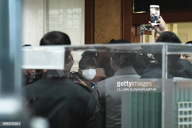 Wattana Phumret a suspect in the bombing of a military hospital on May 22 participates in a crime reenactment inside King Mongkut Hospital in Bangkok...