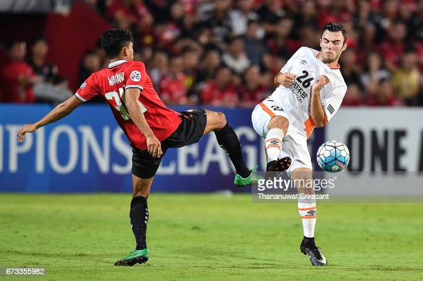 Wattana Playnum of Muangthong United and Nicholas D'Agostino Brisbane Roar competes for the ball during the AFC Asian Champions League Group Stage...