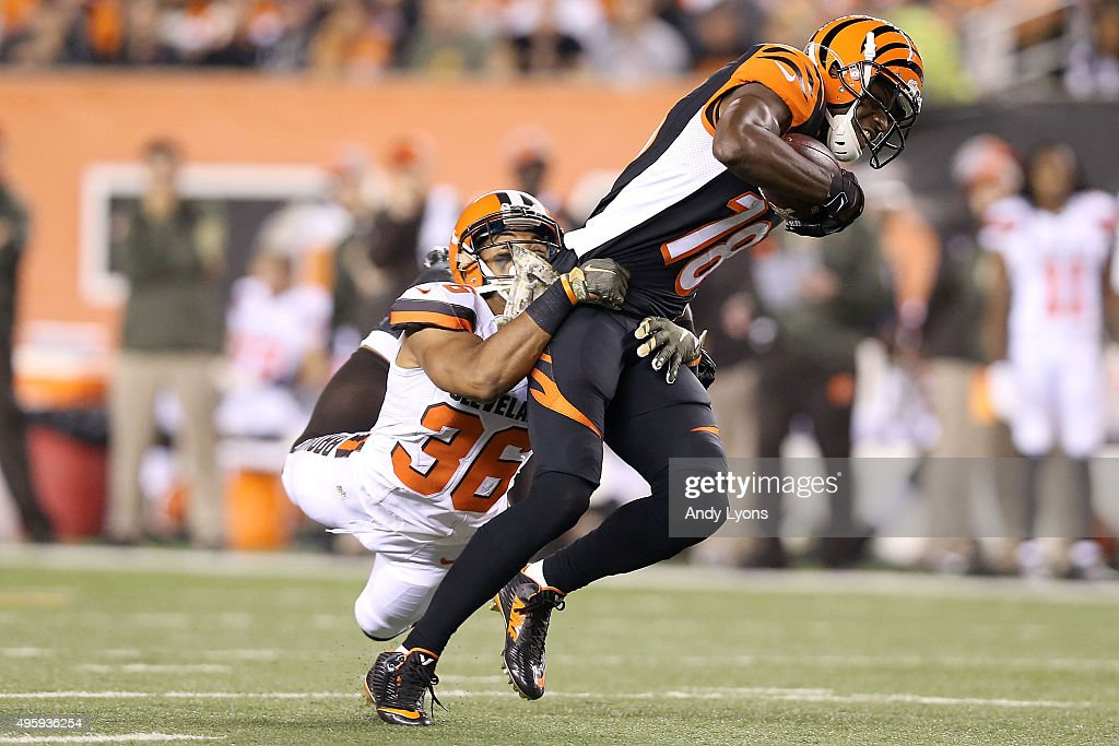 K'Waun William #36 of the Cleveland Browns tackles <a gi-track='captionPersonalityLinkClicked' href=/galleries/search?phrase=A.J.+Green&family=editorial&specificpeople=5525868 ng-click='$event.stopPropagation()'>A.J. Green</a> #18 of the Cincinnati Bengals during the third quarter at Paul Brown Stadium on November 5, 2015 in Cincinnati, Ohio.