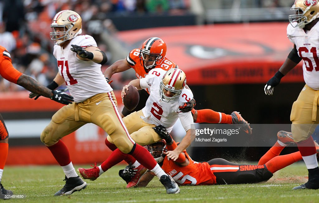 K'Waun Williams #36 and Armonty Bryant #95 of the Cleveland Browns sack Blaine Gabbert #2 of the San Francisco 49ers during the game at Browns Stadium on December 13, 2015 in Cleveland, Ohio. The Browns defeated the 49ers 24-10.