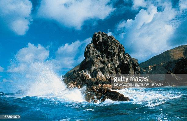 Wave breaking on the rocky coast of Tonga Islands French Polynesia