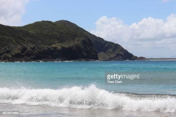 Wave breaks on beach