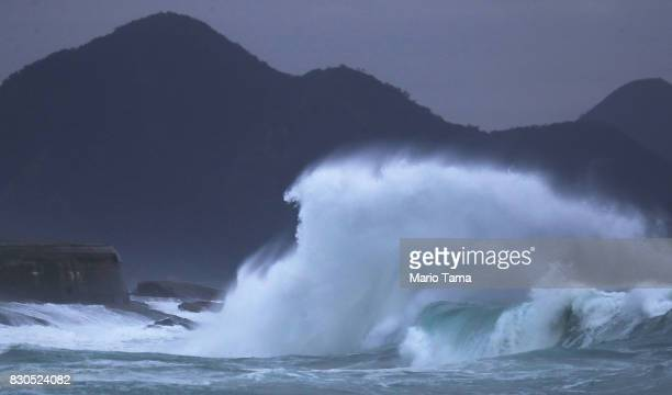 A wave crashes during strong winter swells on the Atlantic Ocean on August 11 2017 in Rio de Janeiro Brazil Waves were measured as high as thirteen...