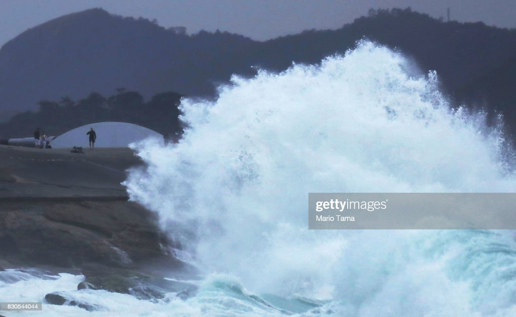 A wave crashes during strong winter swells on the Atlantic Ocean on August 11, 2017 in Rio de Janeiro, Brazil. Waves were measured as high as thirteen feet in Rio today in the middle of Brazil's winter season. According to the Urban Climate Change Research Network (UCCRN), Rio's average temperature would rise around one degree Celsius between 2015 and 2020 along with a sea level rise of 14 cm. Changes in Rio's climate are projected to be the most dire of all cities in South America, according to UCCRN.