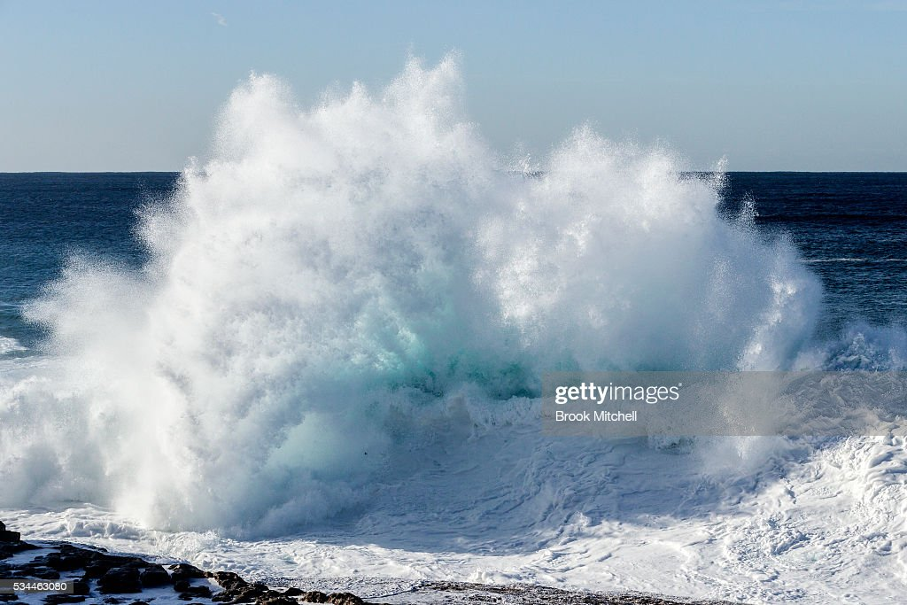 A wave crashes on May 25, 2016 in Sydney, Australia. All Sydney beaches were closed to swimmers as large waves pounded the coast.