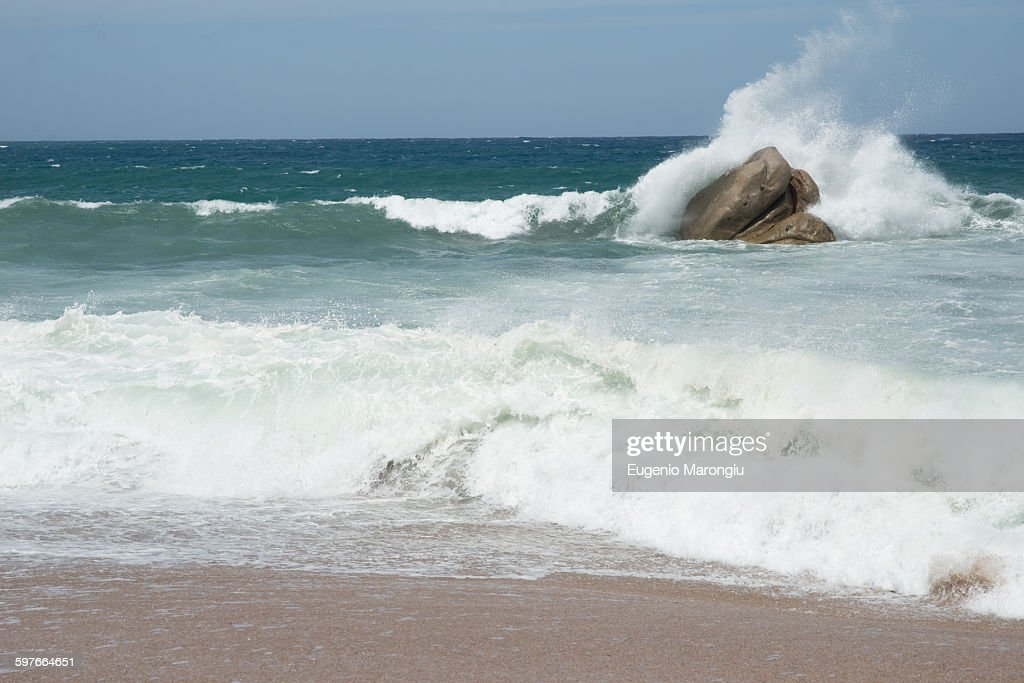 Wave crashing against rocks in ocean, Castelsardo, Sardinia, Italy