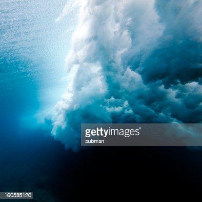 Wave crashing underwater