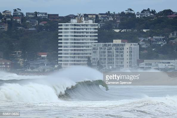 A wave rolls in at Narrabeen as large swell hits the Australian East Coast on June 6 2016 in Sydney Australia Torrential rain over the weekend saw...