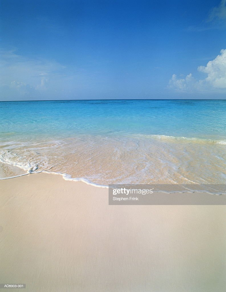 Wave washing onto beach, Cape Santa Maria, Long Island, Bahamas : Stock Photo