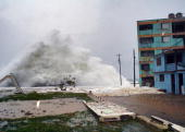 A wave with almost the height of a fivestory building hits the waterfront in Baracoa eastern Cuba on the impending arrival of Hurricane Ike on...