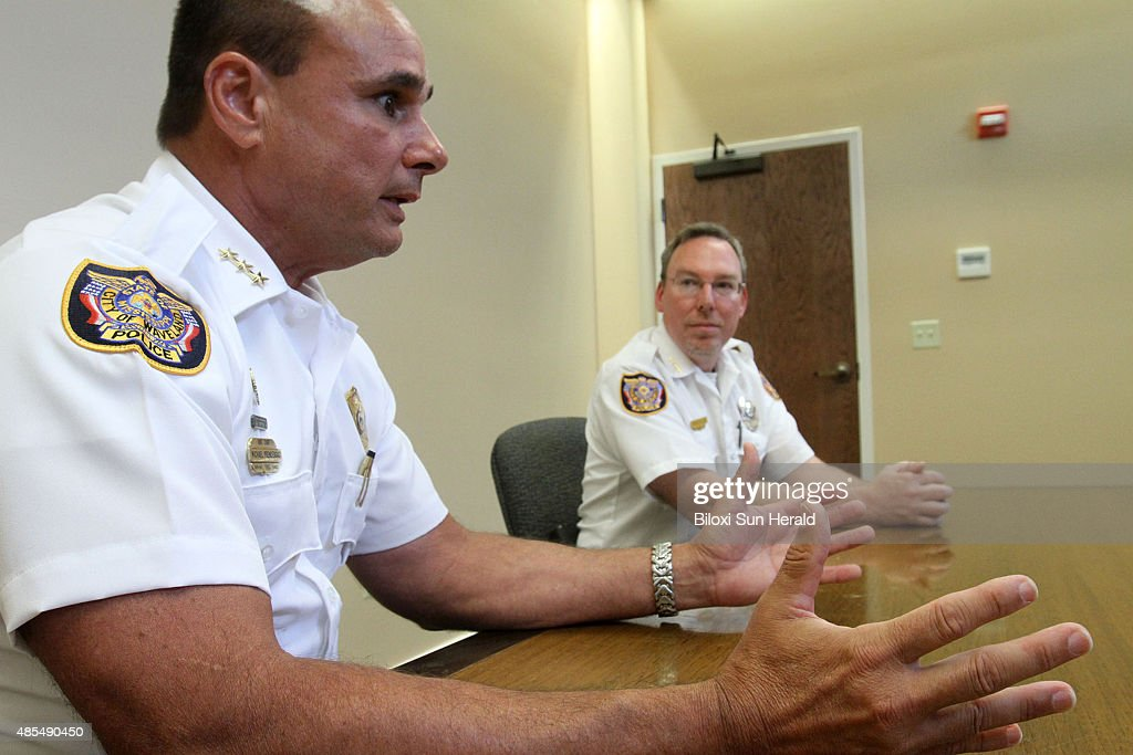 Waveland assistant police chief Michael Prendergast left and chief David Allen talk about surviving Hurricane Katrina by clinging to a tree in front...