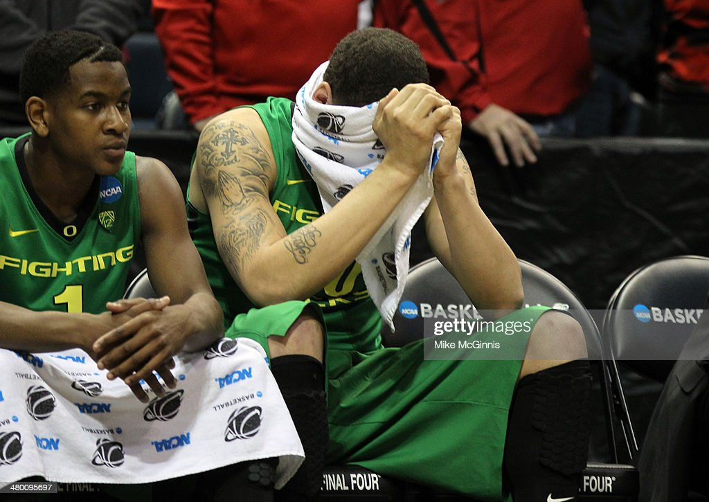 Waverly Austin of the Oregon Ducks react from the bench against the Wisconsin Badgers during the third round of the 2014 NCAA Men's Basketball...