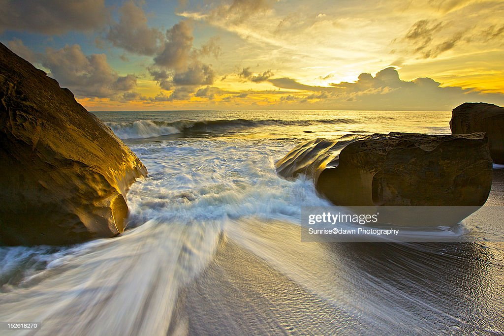 Waves and rocks on beach : Stock Photo