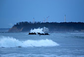 Waves approach at Ukedo beach while facility of the Fukushima Daiichi Nuclear Power Plant are seen on the fifth anniversary of the Great East Japan...