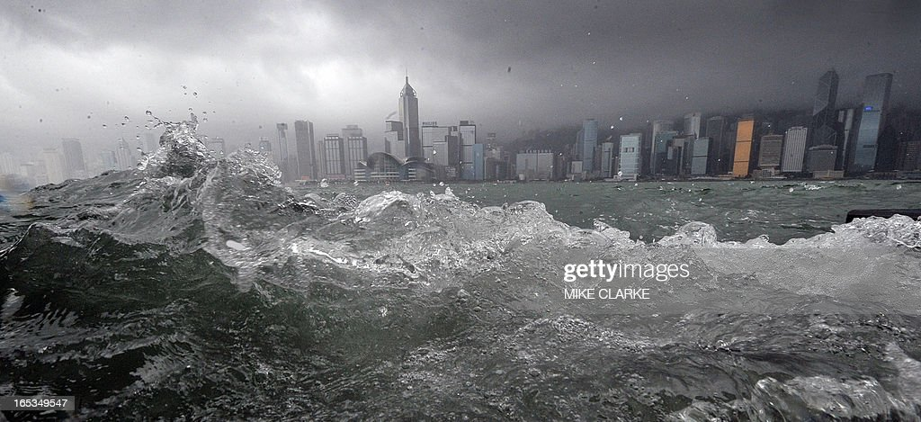 Waves bash the waterfront overlooking Victoria Harbour as a typhoon hit Hong Kong on June 25 2008 The stock exchange schools and public transport...