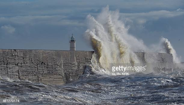 Waves batter the harbour wall in Newhaven on the south coast of England on January 10 2015 after a second Atlantic storm brought strong winds Strong...