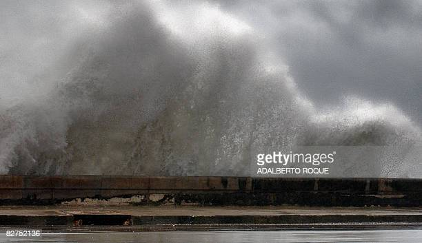 Waves batter the Malecon waterfront in Havana hours before the arrival of Hurricane Ike on September 9 2008 Deadly Hurricane Ike has weakened to a...