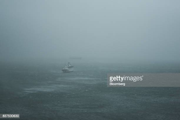 Waves break around a ship during a No 10 Hurricane Signal raised for Typhoon Hato in Hong Kong China on Wednesday Aug 23 2017 Hong Kong upgraded the...