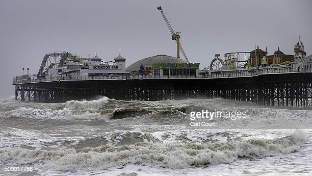 Waves break around Brighton Pier on February 8 2016 in Brighton East Sussex Storm Imogen is the ninth named storm to hit the UK this season This...
