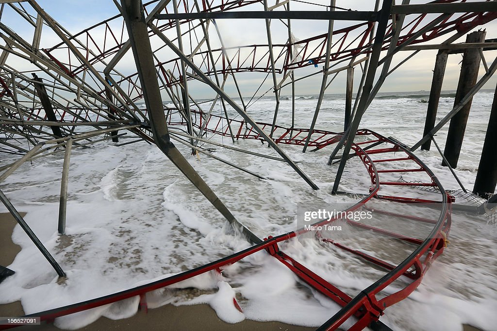 Waves break at a destroyed roller coaster from the Funtown Pier on November 16, 2012 in Seaside Heights, New Jersey. Two amusement piers and a number of roller coasters in the seaside town were destroyed by Superstorm Sandy.