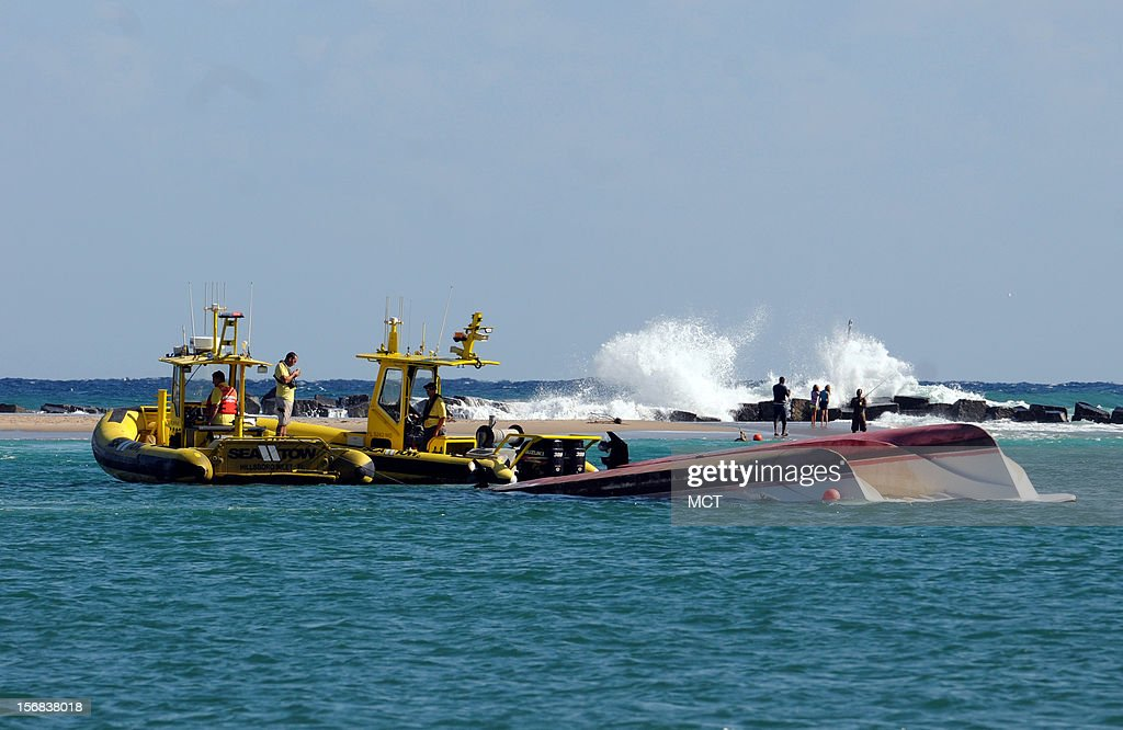 Waves break behind a dive boat that capsized off Hillsboro Inlet near Pompano, Beach, Florida, Thursday, November 22, 2012. Four people were transported to an area hospital, one in critical condition. A commercial dive boat was hit by a massive wave and capsized just outside Hillsboro Inlet, officials said.